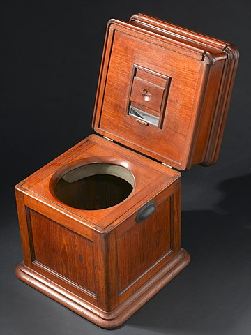 Photograph of a mid to late nineteenth century piece of furniture designed to hide a chamber pot and likely also prevent it from being tipped or knocked over, Wellcome Trust item L0057869.