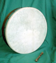 Bodhran and tippin for playing it, courtesy of wikimedia commons, photo by RichL, march 2004.