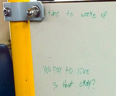 You'd be surprised where existential questions can turn up. This one says, 'time to wake up you pay to live is that okay?'