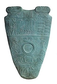 One side of the ancient egyptian namer palette.